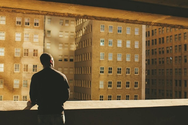 Man gazing at surroundings from office thinking